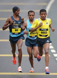 Kenenisa Bekele, Haile Gebrselassie and Mo Farah race during the Great North Run on September 15, 2013 in Gateshead, England.