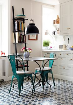 Love the blue chairs in the simple kitchen
