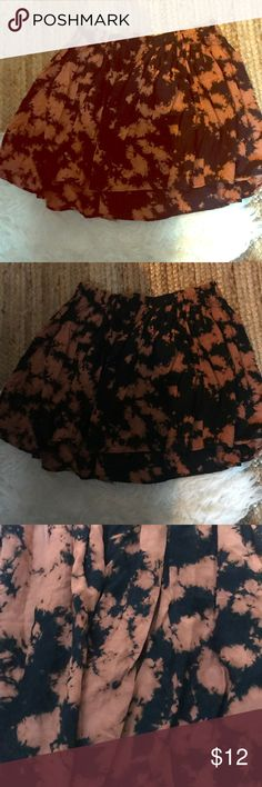 UO Skater skirt, multi color/pattern. Never worn Urban Outfitters Ecote skater skirt. Black and rust color with multi mix pattern. Super cute and never worn! Needs to be steamed or ironed. Soft material. Size large. Ecote Skirts Circle & Skater