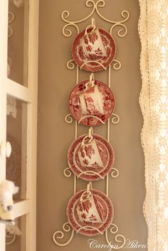 red transferware on gray walls (with creamy lace curtains on the window)