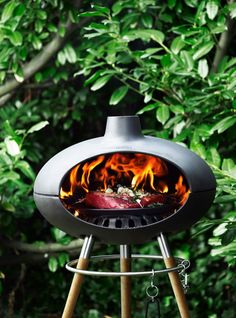 The Morsø Grill Forno is made of cast iron and wood. The cast iron grate means you can use both coal and wood.