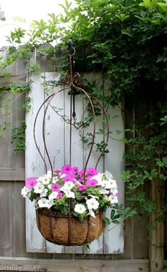 shabbystory-flower-basket Added oomph from the door behind it. An idea for the back of my shed