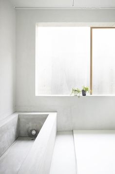concrete bathroom in House in Koamicho, Hiroshima, Japan