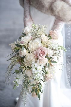 Romantic light pinks , soft whites , cascading winter bouquet