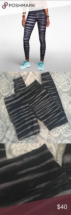 Nike Legend 2.0 Tiger Stripe Leggings Full length Nike Legend 2.0 Tiger Stripe DRI-FIT Leggings. Black/Grey. Size medium. Excellent preowned condition. Made of 88% polyester and 12% spandex. Nike Pants Leggings