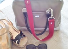 Love neutrals! Jewell's Trendsetter satchel with a red statement strap.
