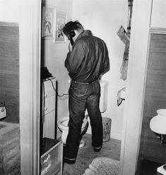 And like all of us, he sometimes talked on the phone while going to the bathroom. | 9 Photos That Will Change The Way You See James Dean