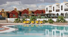 Fuerteventura Beach Club Caleta De Fuste Fuerteventura Beach Club is km from Fuerteventura's Cala de Fuste Beach, and a drive from the airport. Set in tranquil gardens, it has 2 outdoor swimming pools. The Beach Club is 2 km from Fuerteventura Golf Club. Outdoor Swimming Pool, Swimming Pools, New Years 2016, Year 2016, Holiday Park, Cheap Hotels, Beach Club, Spain, Mansions