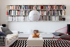 Living room with lot of books but an airy style