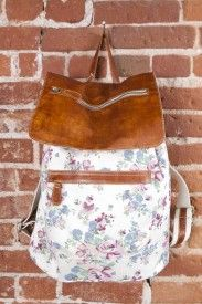 Leather flap backpack floral; this website has cute bags!
