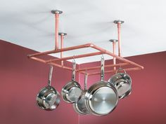 A pot rack made from reclaimed copper piping