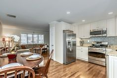 Traditional Kitchen with U-shaped, High ceiling, Crown molding, flush light, Breakfast nook, Subway Tile, Flush, Raised panel