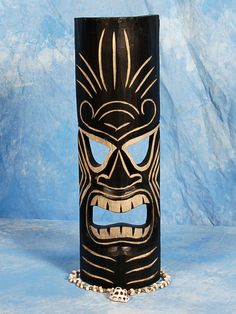 """Here is a hand carved Tiki mask with a beautiful finish. This ku mask - Tiki of strength was hand carved with great attention to details (ready to hang!). Measurement: 20"""" by 6 inches Tiki: money Tiki"""