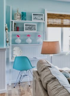 Create an office nook in your living room or any room with an airy leaning ladder shelf / office desk. The vertical shelf space can be used to display a few decorative items. Featured on Completely Coastal along with many other coastal style office nook ideas for the home.