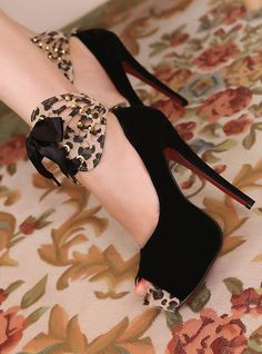 ..Sexy.... Christian Louboutin Lady Daf Black Stilettos with a hint of animal print.