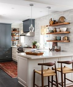 Gorgeous white kitchen with gray, beautiful wood tones, marble subway tile and open shelving