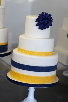 Yellow and navy wedding cake change the yellow to orange and it's my favorite cake so far!
