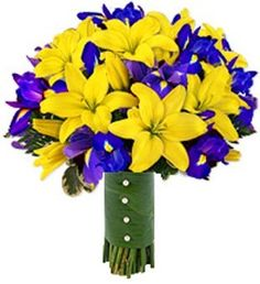 This bouquet features yellow Asiatic Lilies and purple/blue Iris for a fun contrast. Asiatic Lilies and Iris are available year-round at GrowersBox.com.