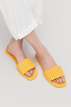 Perfect pedicure slides! // Side image of Cos scalloped rubber sliders in yellow