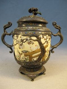 Japanese inlaid Lidded Shibayama vase Ornate over a beige background ~ Trees~ Fence and two birds sitting on it ~ Ornate dragon handled ~ Circa Meiji Period