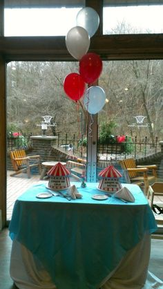 I would say this balloon centerpiece complements the cakes perfectly!    Check us out: www.codypartytorontobeaches.com