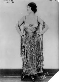 1920, Gown of colored beads on gold netting.  From Vintage Dress Ups: The Roaring Twenties