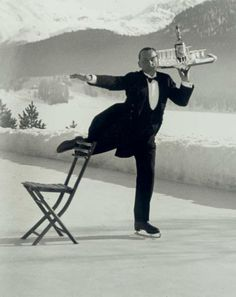 Headwaiter Rene Breguet brings aperitifs at the skating rink of the Grand Hotel, Saint-Moritz, 1932. by A.Eisenstadt
