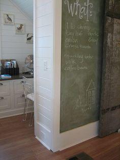 chalkboard wall...and desk behind,  mud room?