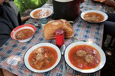 Ciorbă_ (from the Turkish çorba) is the Romanian name for a soup that has been soured—in this case, with a generous shot of fresh lemon juice. Pork-and-rice meatballs bring savory flavor and substance to the paprika-spiced broth.