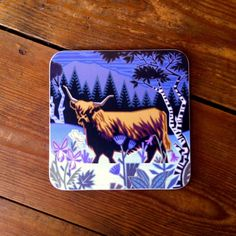 Hard-wearing melamine #coaster featuring a beautiful #highland #cow #design by #British #artist Jenny Tylden-Wright.  #countryside #wildife #moonlight #mountains #trees #cattle #farming #animals
