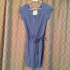 H&M tshirt dress NWOT Super cute H&M dress to throw on and go. Buttons and pleating on the front and comes with a fabric belt to cinch at the waist. Never worn and in perfect condition. The photos represent the periwinkle color pretty well. H&M Dresses Mini