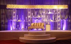 Grand stage design for hotel ceremony. #stage design #flowers #purple