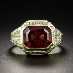 Vintage Garnet Ring. From the 1920-30s, this tailored and refined Art Deco signet style ring, crafted and hand-engraved in 14K yellow gold, glistens with a lovely, rich, dark cinnamon colored emerald-cut garnet, weighing 3.50 carats.