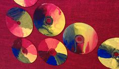 Color wheel painted on old CDs by 4th graders