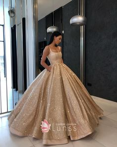 0bf8bbb695 Prom Dresses 2019 · Sparkly bronze glitter overlay floor length satin ball  gown with scoop neckline, wide shoulder straps