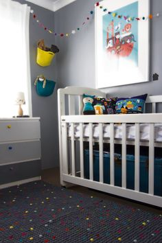 An old playroom turned vibrant nursery for our newborn baby, Caleb featuring a pixel rug, ombre dresser, DIY deer head and little house wall decals. Nursery Decor Boy, Project Nursery, Nursery Ideas, Gray Rooms, Room Corner, House Wall, Nursery Inspiration, Animal Nursery, Hanging Baskets