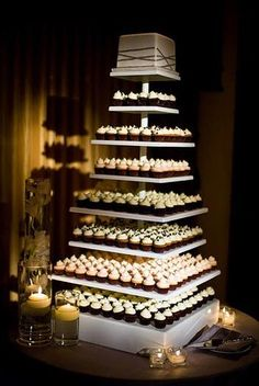 Awesome cupcake display in lieu of wedding cake.