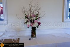 !dupcak-13-whitby-castle-rye-wedding-flowers-place-card-table-arrangement-tall-roses-lilies-hydrangea-curly-willow