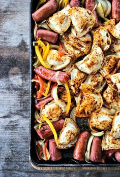 Take a one-pot dinner to the next level with this baked Kielbasa and Pierogies Sheet Pan Meal. It's a delicious and efficient way to get dinner on the table even on the busiest nights. - Kielbasa and Pierogies Sheet Pan Meal Sausage Recipes, Pork Recipes, Cooking Recipes, Pan Cooking, Sausage Crockpot, Meatless Recipes, Fun Recipes, Pierogies And Kielbasa, Vegans
