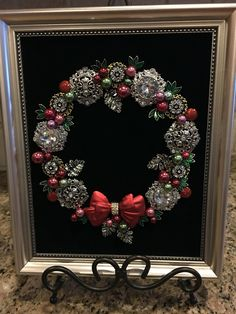 Wreath on black velvet mix of old and new Jewelry. By Beth Turchi 2015