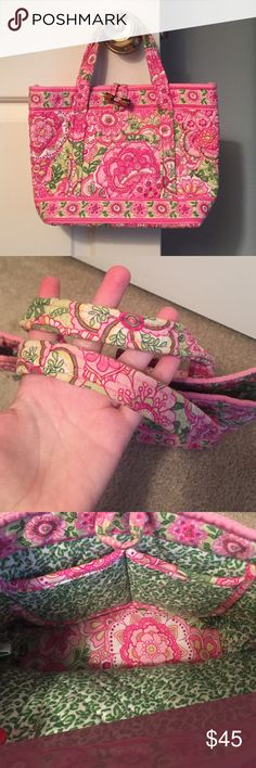 Vera Bradley Petal Pink and Green tote bag Gorgeous pink and green floral bag from Vera Bradley! Gently used condition, some fading on handles and closure. Could use a washing and I'm sure those parts would shine like new! Cheetah print interior. Vera Bradley Bags Mini Bags