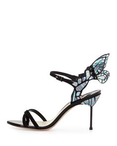 """Sophia Webster suede and metallic calf leather d'Orsay sandal. 4"""" covered stiletto heel. Crisscross straps band open toe. Scalloped heel counter. 3D butterfly wings extend from backstay. Adjustable an"""