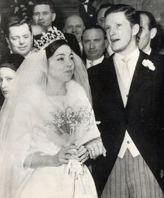 The wedding of ex-King Simeon of Bulgaria and Margarita Gomez-Acebo y Cejuela granddaughter of the Marquis of Cortina.  She is wearing the famous tiara of Marie Louise of Bourbon Parma, Queen of Bulgaria, who was the daughter of Robert of Bourbon Parma, son of Louise of Artois.  The fleur de lys is a symbol of the French Royal Family.
