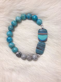 Blue agate, gray jasper, and turkey turquoise bracelet on Etsy, $10.00