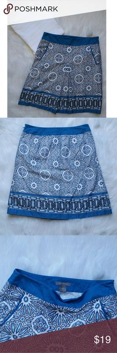 Ann Taylor Geometric Skirt Blue Ann Taylor geometric tile print skirt. Solid blue ay the waist and hem. Side zipper. Two pockets on the front. 100% cotton with 100% acetate lining. Ann Taylor Skirts