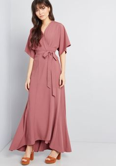 Everlasting Impression Maxi Wrap Dress Your presence in this dusty rose wrap dress won't be forgotten anytime soon. Kimono-style short sleeves, a classic surplice bodice, and a slight high-low hem come together to form this timeless-yet-impactful maxi dress - a ModCloth exclusive style designed to wow the crowd.