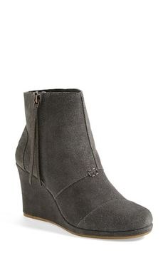 Free shipping and returns on TOMS 'Desert' Wedge High Bootie (Women) at Nordstrom.com. A pieced leather bootie set on a sleek wrapped wedge makes for a versatile style that toes the line between casual and sophisticated. <br><br>Since Blake Mycoskie started TOMS in 2006, the company has given away 10 million shoes to children in need across the globe through sales of their now-iconic shoes and their innovative 1-for-1 donation program.