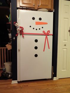 Elf on a Shelf - Decorated the fridge to look like his friend Frosty