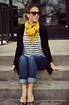 animal print shoes; yellow scarf; black sweater; stripped blouse