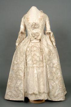 Wedding Dress of Cream Silk.